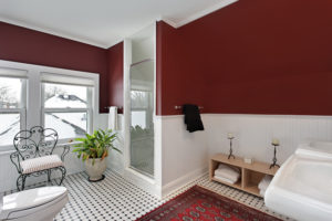 Bathroom with red walls and white siding